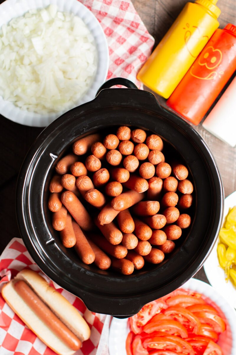 cooked hot dogs in a round slow cooker.