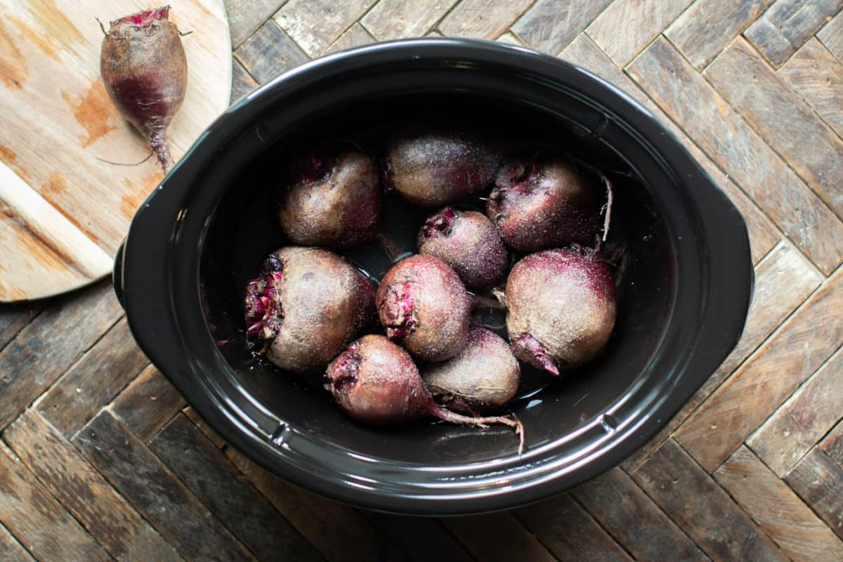 uncooked beets in slow cooker with skins on