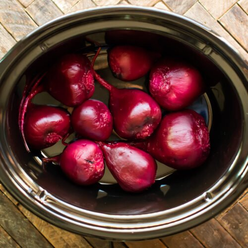Peeled and cooked beets in slow cooker