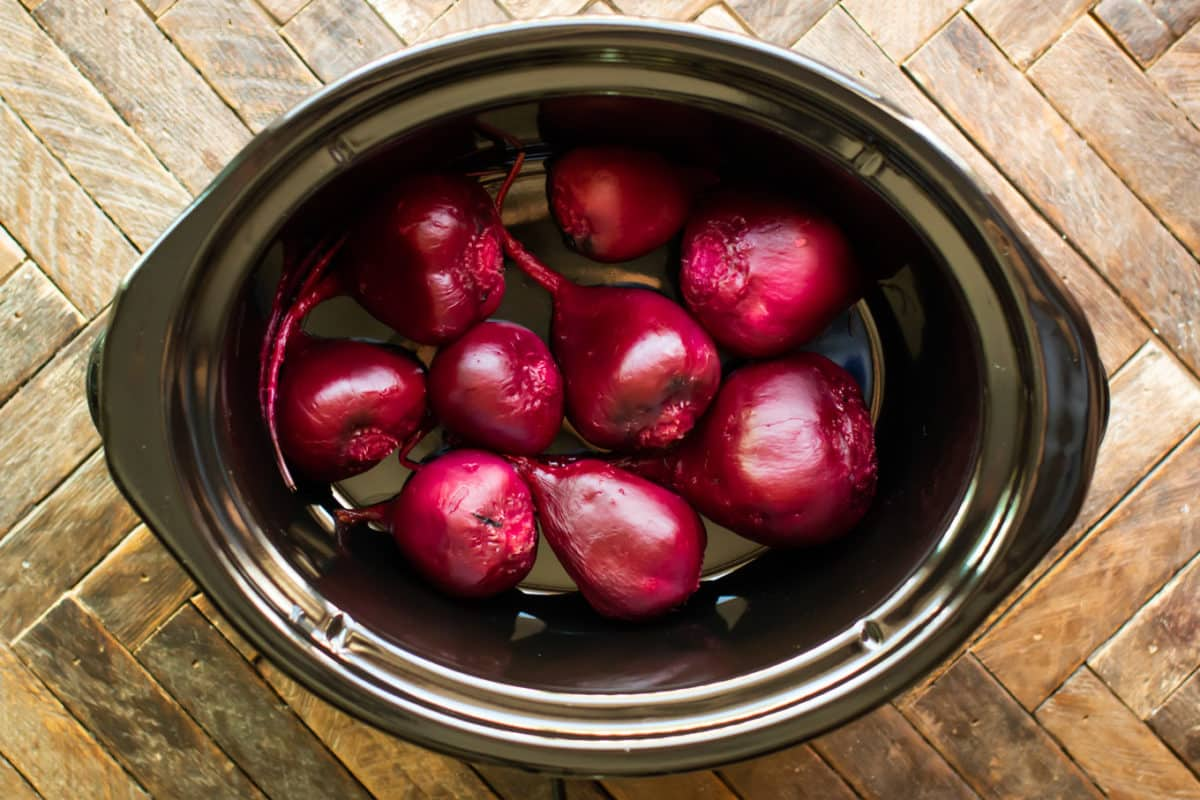 Cooked and peeled beets in the slow cooker.
