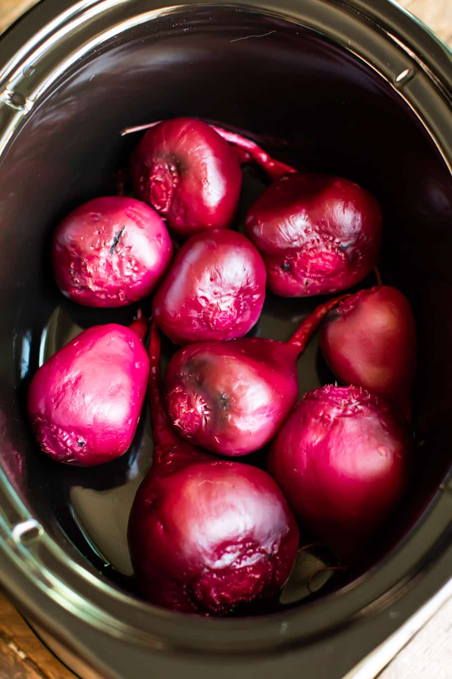 Peeled beets in slow cooker, whole.