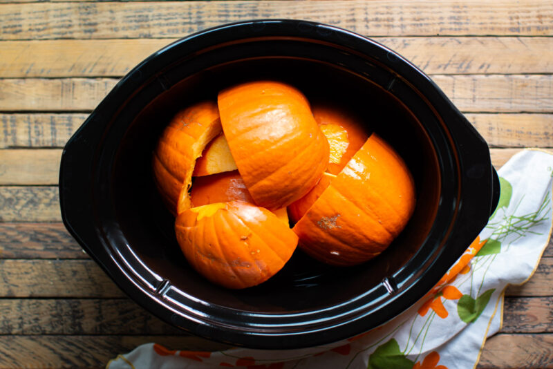 pumpkin pieces in the slow cooker.