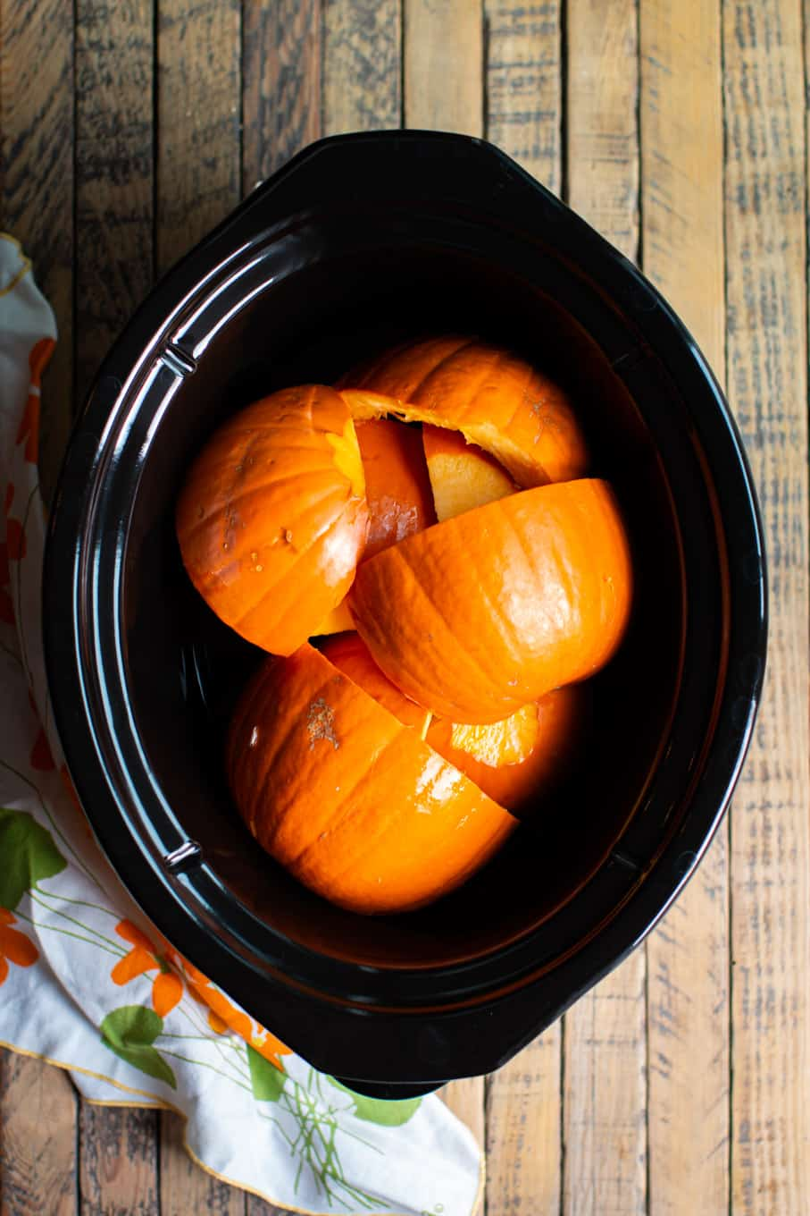 cut up pumpkin in the slow cooker.