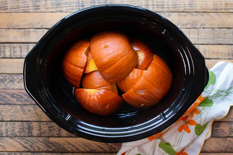cooked pumpkin pieces in the slow cooker.