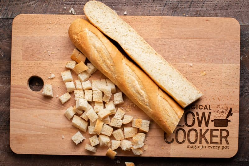 A wooden cutting board, with Bread