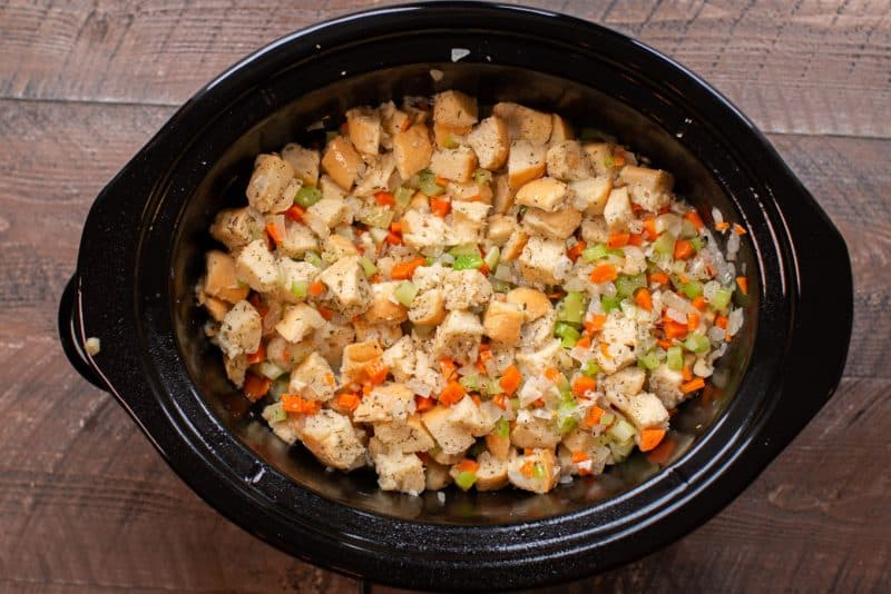 uncooked mixed stuffing in a slow cooker