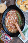 Multi bean soup in the slow cooker. Sprigs of rosemary on top.