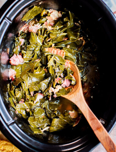 close up of collard greens with ham hocks.
