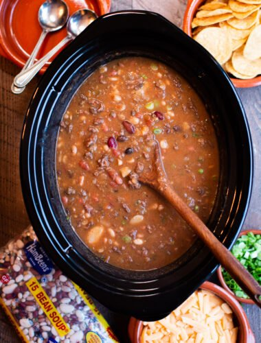 slow cooker full of taco 15 bean soup. Wooden spoon in it.