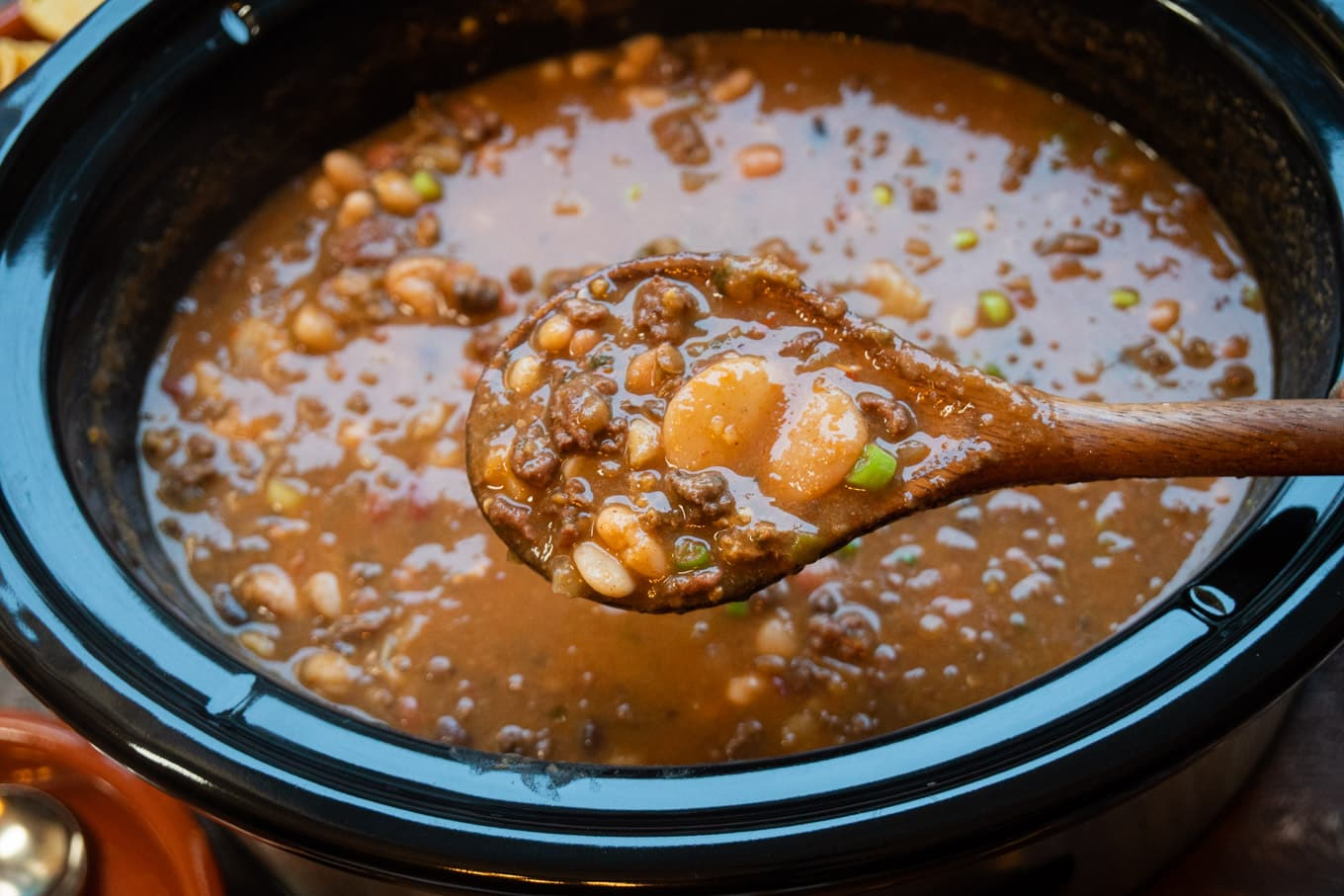 taco 15 bean soup in slow cooker with spoon scooping it out