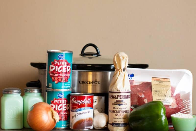 ingredients for swiss steak in front of crockpot