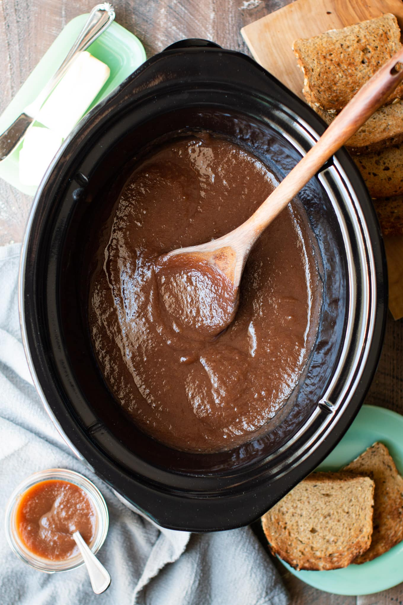 slow cooker half full of cooked apple butter