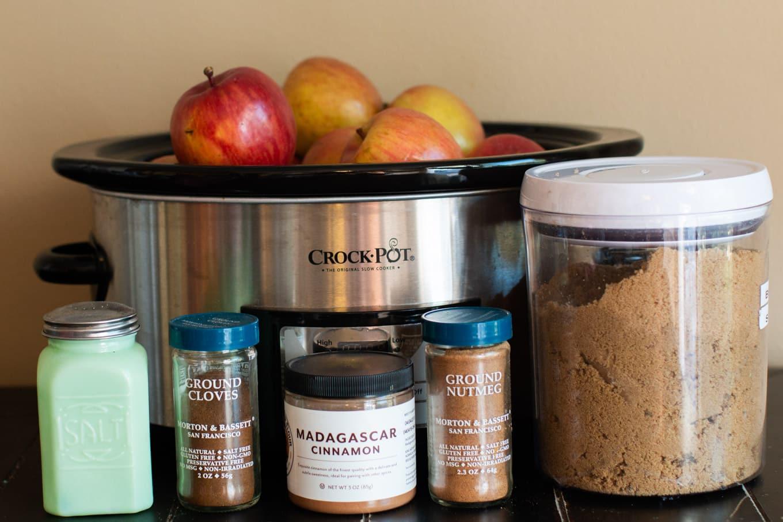 Ingredients for apple butter, apples, salt, cinnamon, nutmeg, cloves and brown sugar.