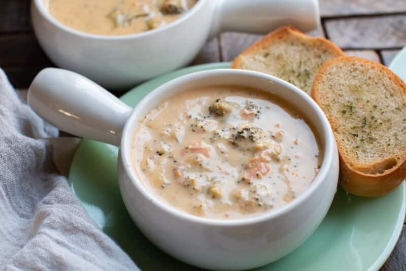broccoli cheese soup with garlic bread on side