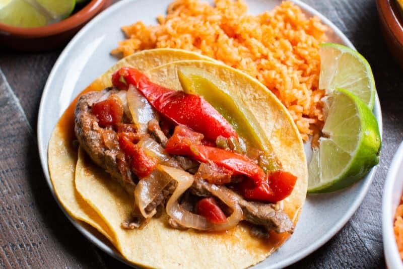 extra close up photo of beef fajitas on corn tortillas