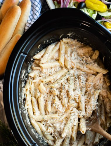 close up of pasta, chicken and cheese in slow cooker