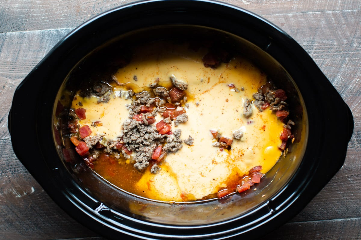 melted velveeta in slow cooker with ground beef and rotel