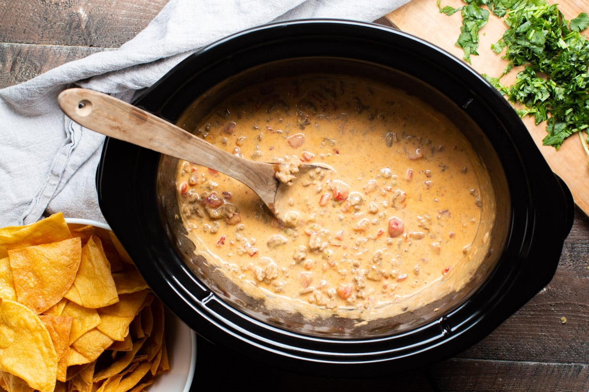 spoon in rotel dip in slow cooker