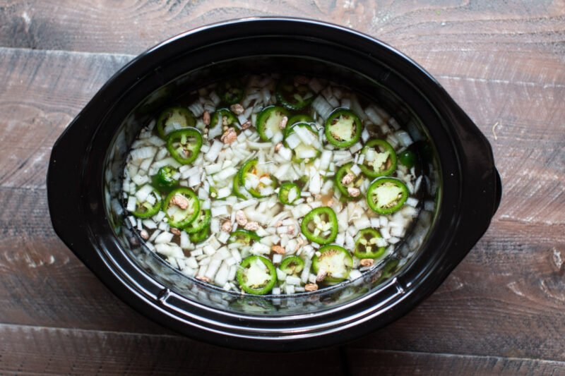 onions, pinto beans and jalapenos in slow cooker