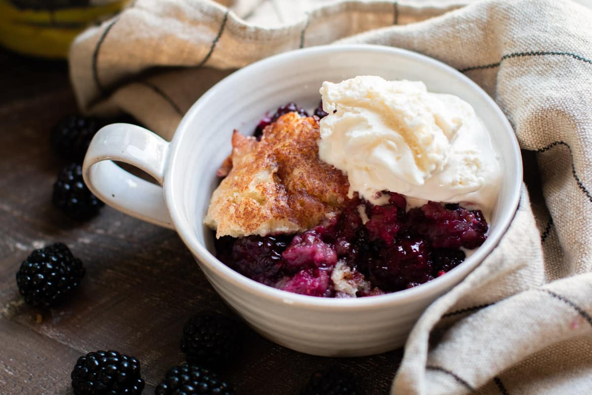 bowl with cobbler and ice cream on top.