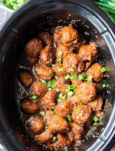 Close up of meatballs in teriyaki sauce in slow cooker