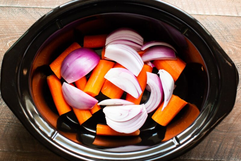 carrots and red onion in a slow cooker