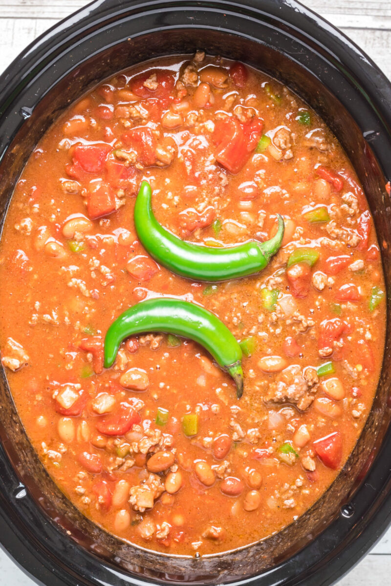chili with 2 serrano peppers on top