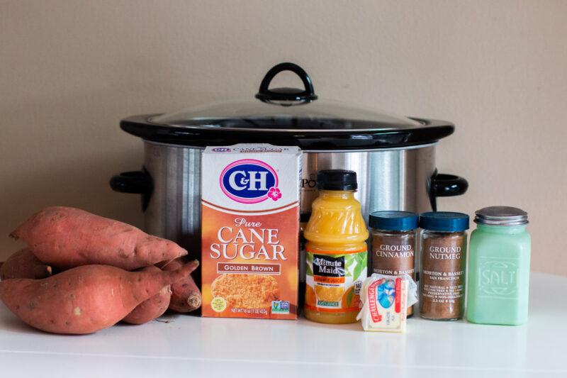 sweet potatoes, brown sugar, nutmeg, cinnamon, salt, orange juice and butter in front of slow cooker