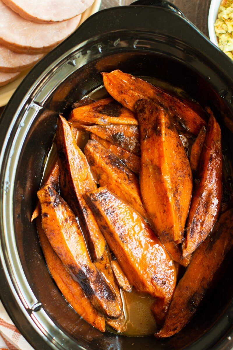 close up of sweet potatoes wedges in a slow cooker