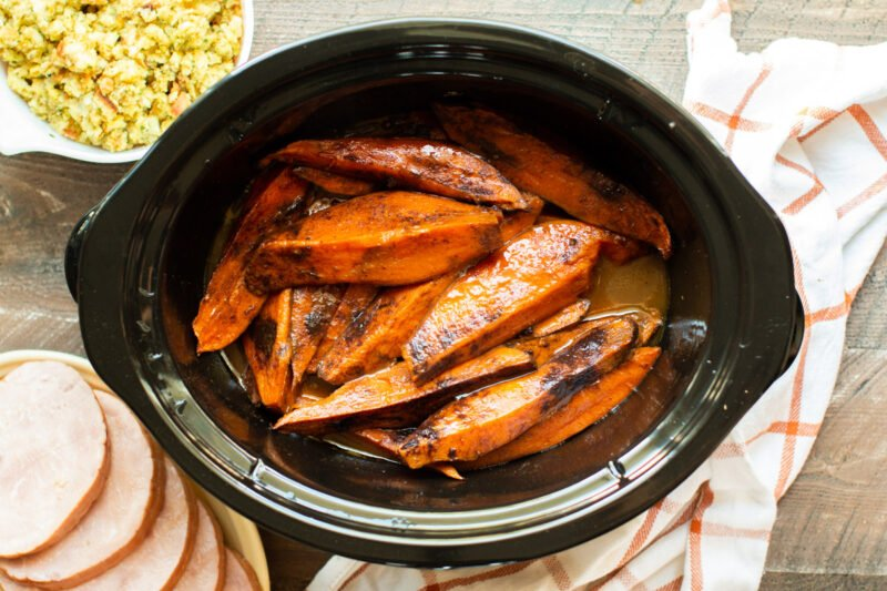 finished cooking sweet potato wedges with cinnamon on top.