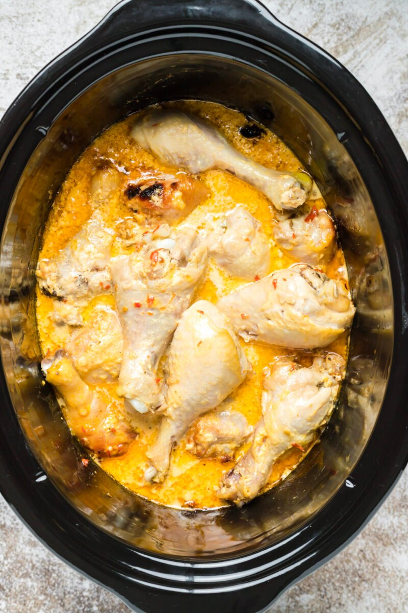 chicken drumsticks cooked in bang bang sauce in slow cooker