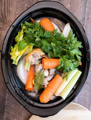 veggies, turkey and water in slow cooker