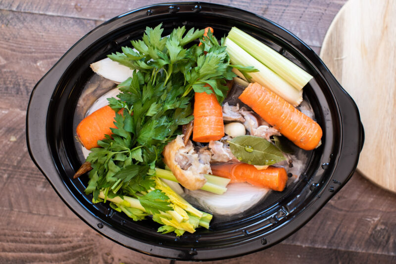 Turkey pieces, parsley, carrots, celery, onion, water and bay leaves in a slow cooker
