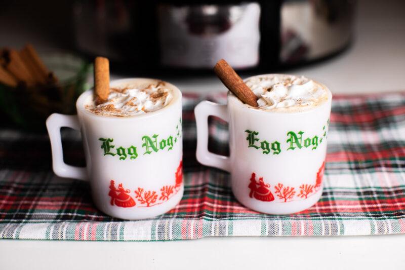 2 white mugs that say egg nog on them