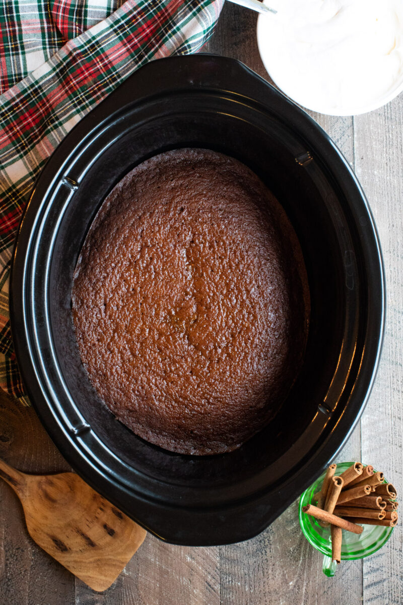 close up of cooked gingerbread cake in slow cooker