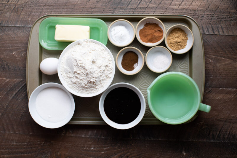 ingredients for gingerbread cake on a sheet pan