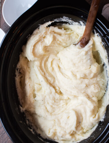 Slow Cooker Mashed Potatoes with wooden serving spoon