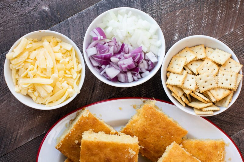 bowl of cheese, onion and crackers. Platter of cornbread.