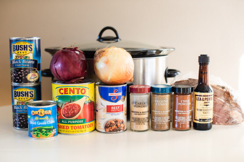 ingredients for prime rib chili in front of a slow cooker