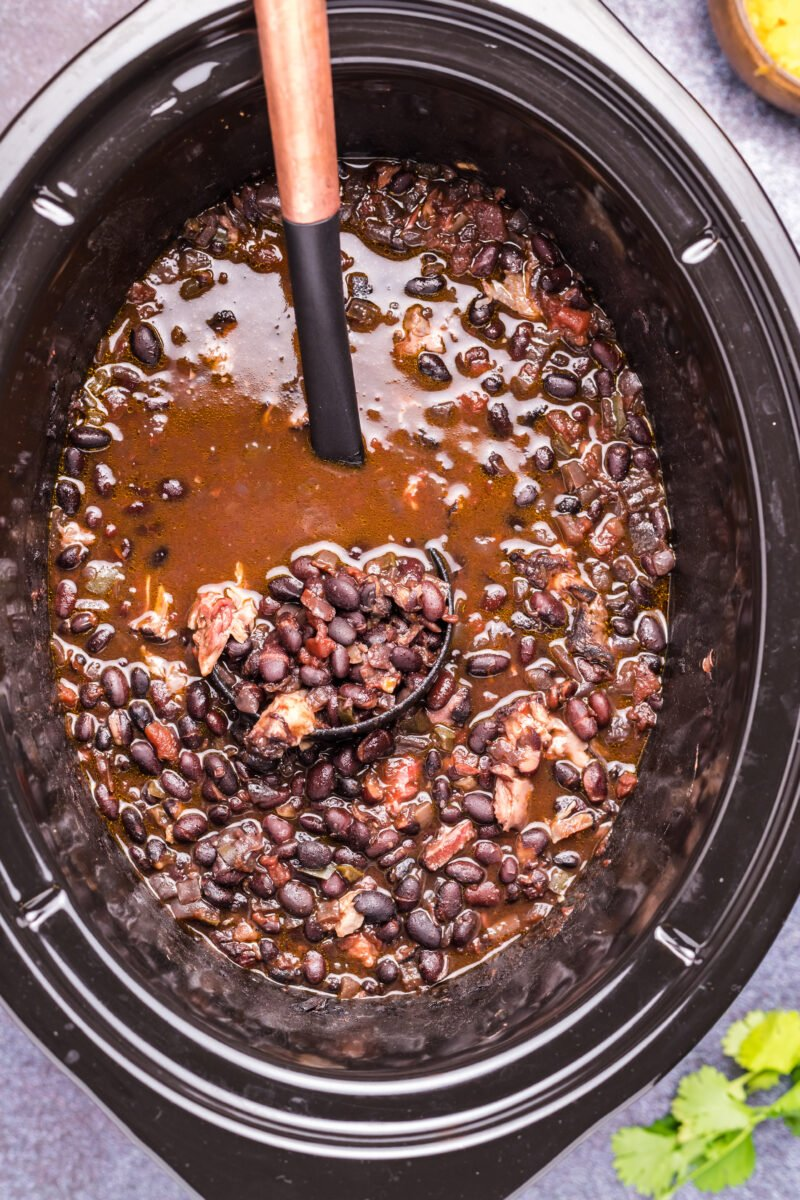 close up of black bean soup in slow cooker