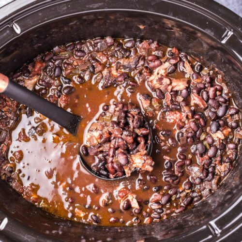 black bean soup on ladle in slow cooker