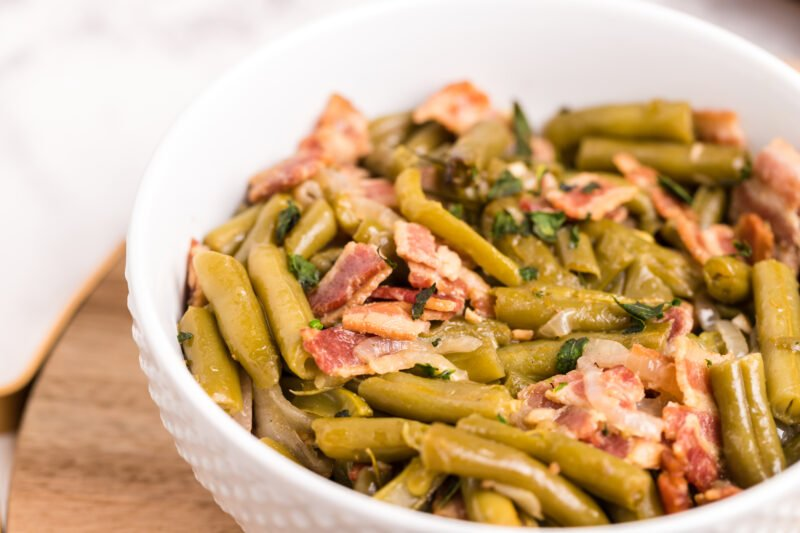 white bowl with green beans in it