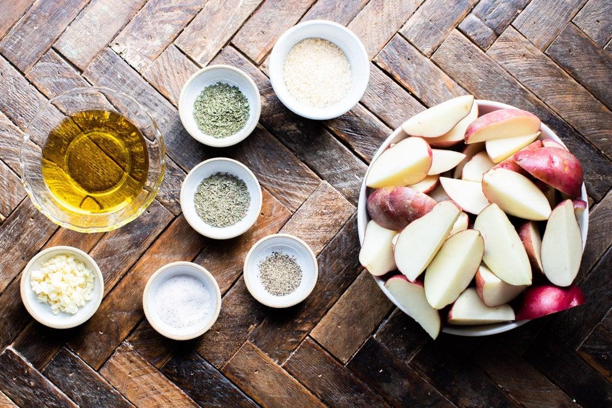 ingredients for garlic parmesan potatoes on wood table