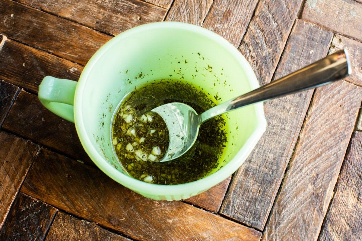 oil, seasoning and garlic in green bowl