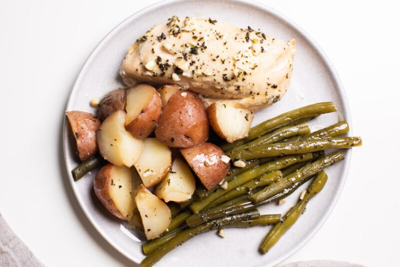 plated chicken potatoes and green beans
