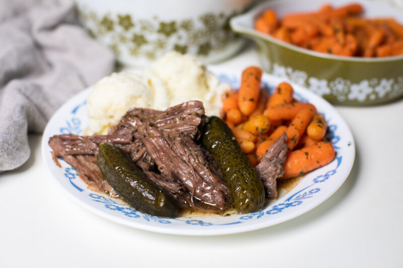 shredded beef with pickles on plate