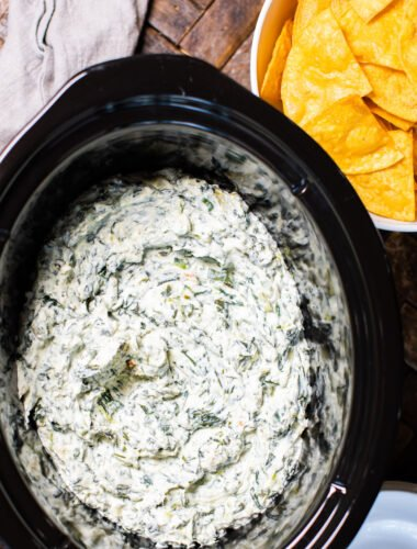 spinach dip, done cooking in a slow cooker