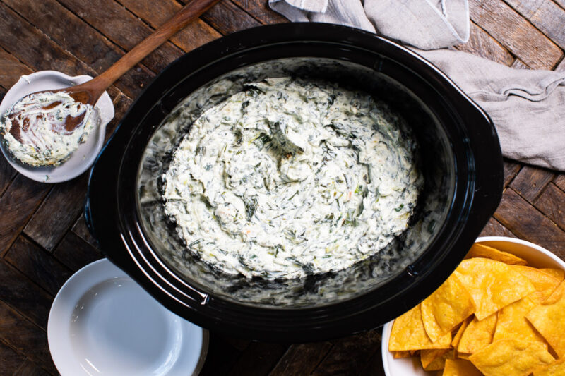 spinach dip with corn chips on the side