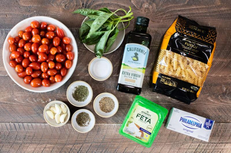 ingredients for feta tomato pasta on wooden table