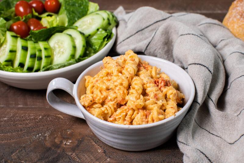 feta tomato pasta in a white bowl